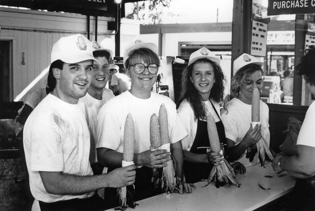 . The staff poses with the product at the roasted corn booth during the 1990 Minnesota State Fair. Photo courtesy of the Minnesota State Fair.