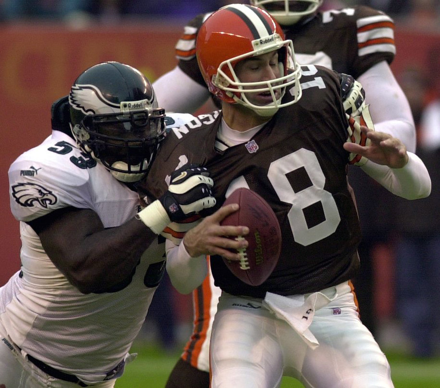 . News-Herald file Cleveland quarterback Doug Pederson is sacked from behind Eagles defensive lineman Hugh Douglas ending the first half of play during yesterdays Browns loss.