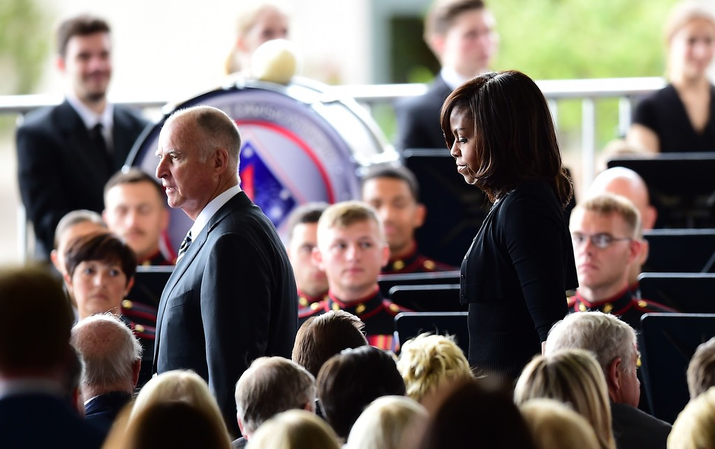 . (L-R) California Governor Jerry Brown and US First Lady Michelle Obama arrive for the funeral service of former US First Lady Nancy Reagan on March 11, 2016, at the Ronald Reagan Presidential Library in Simi Valley, California.  AFP PHOTO/FREDERIC J. BROWN/AFP/Getty Images