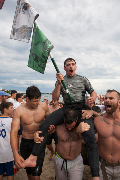 Jake Wagner wins Sunday's Greasy Pole during the 90th annual  St. Peter's Fiesta.