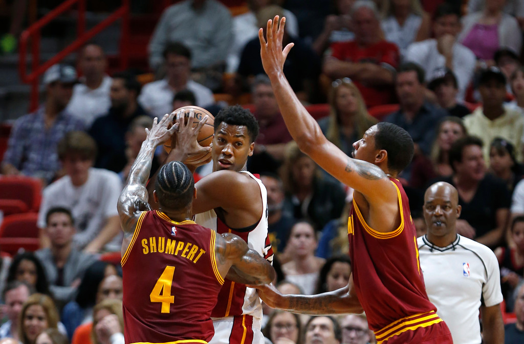 . Miami Heat center Hassan Whiteside, center, looks for an opening past Cleveland Cavaliers guard Iman Shumpert (4) and forward Channing Frye during the first half of an NBA basketball game, Monday, April 10, 2017, in Miami. (AP Photo/Wilfredo Lee)