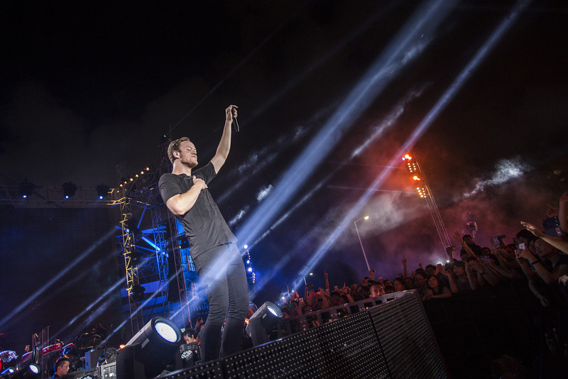 """. Dan Reynolds of Imagine Dragons performs on stage at the Ocean Terminal Rooftop Car Park to celebrate the worldwide premiere screening of \""""Transformers: Age of Extinction\"""" on June 19, 2014 in Hong Kong, Hong Kong.  (Photo by Jerome Favre/Getty Images for Paramount)"""