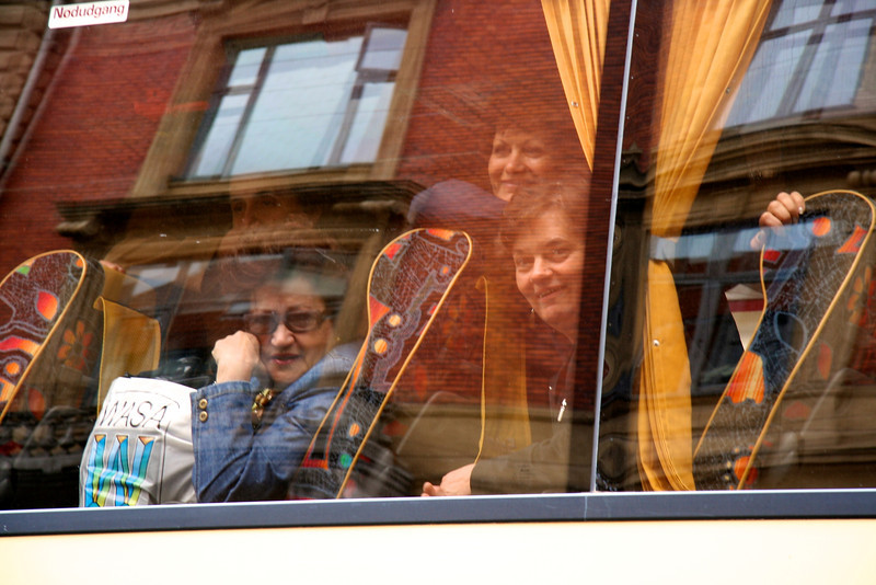 Tourists in a bus overlooking the Pride