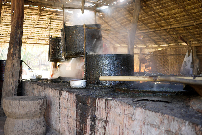 Huge boiling vats of sugarcane juice are being processed into candies near Nyaung Shwe, on Inle Lake, Burma (Myanmar).