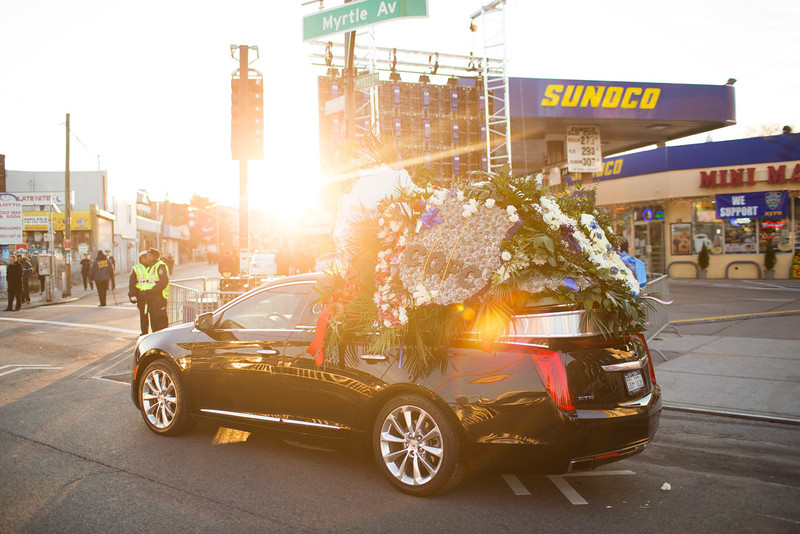 . Flowers are carried on top of a vehicle before the funeral of slain New York City Police Officer Rafael Ramos, one of two officers murdered while sitting in their patrol car in an ambush in Brooklyn last Saturday afternoon on December 27, 2014 in New York City. Thousands of fellow officers, family, friends and Vice President Joseph Biden are expected at the church in the Glendale neighborhood of Queens for the funeral. (Photo by Kevin Hagen/Getty Images)