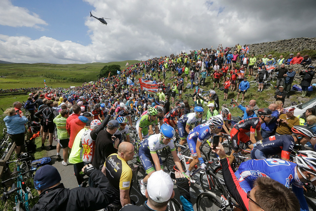 . The pack climbs Cray pass during the first stage of the Tour de France cycling race over 190.5 kilometers (118.4 miles) with start in Leeds and finish in Harrogate, England, Saturday, July 5, 2014. (AP Photo/Laurent Cipriani)