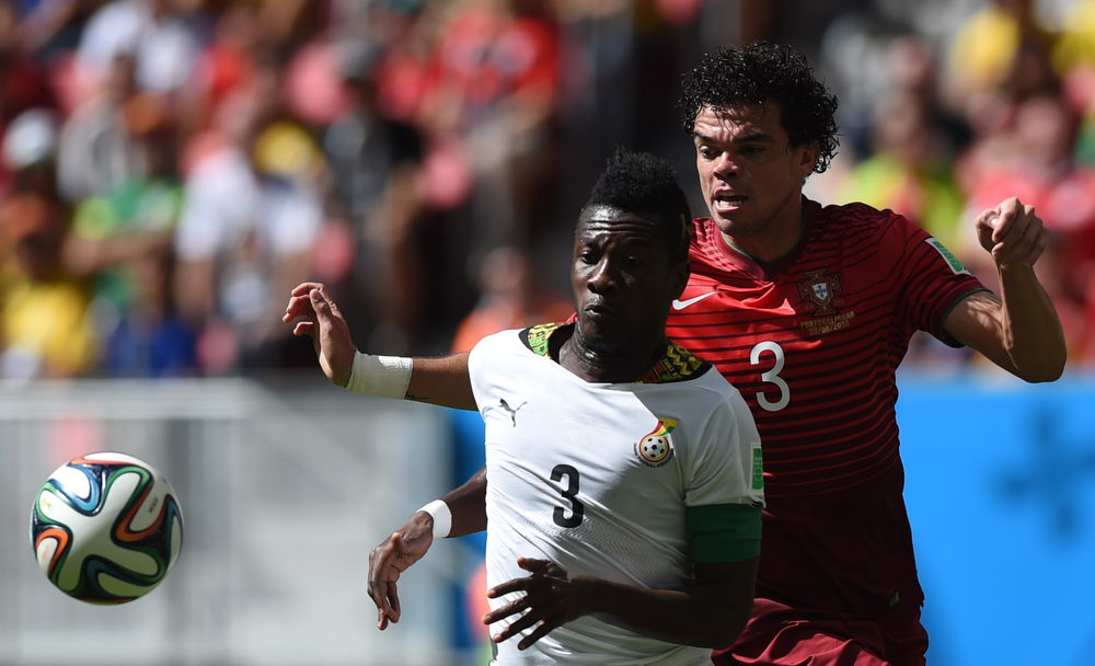 . Ghana\'s forward and captain Asamoah Gyan (L) and Portugal\'s defender Pepe vie during the Group G football match between Portugal and Ghana at the Mane Garrincha National Stadium in Brasilia during the 2014 FIFA World Cup on June 26, 2014.  (FRANCISCO LEONG/AFP/Getty Images)