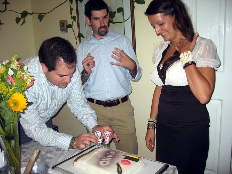Craig adds Olivia's birthday candles.