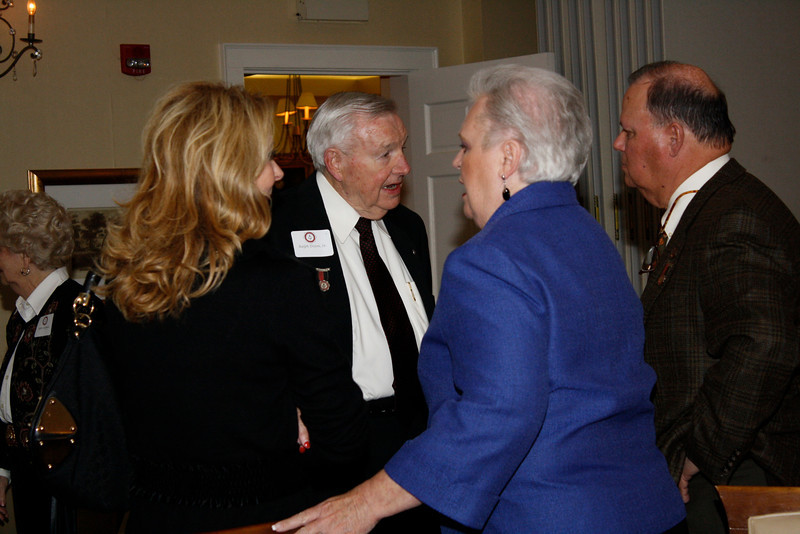 Ralph Dixon Sr. speaks with Neal Alexander, his wife and Scoot Dixon's wife.