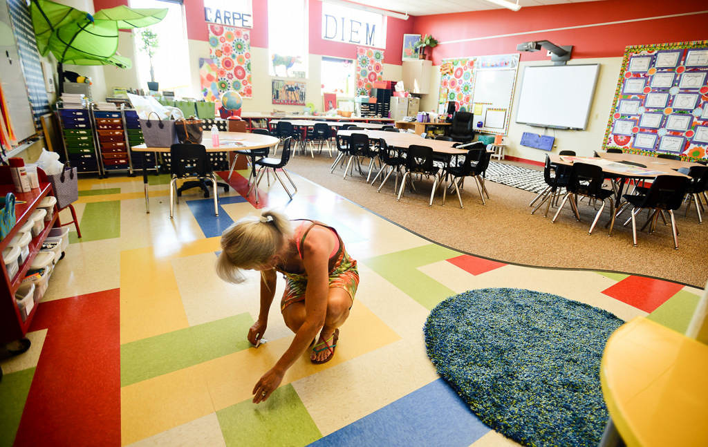 ". Anne Miller cleans the floor in her second-grade classroom at the new Wildwood Elementary in Grant, Minn., on Monday, August 13, 2013. ""It\'s going to be amazing,\"" said Miller about the new school. There will be a community open house Tuesday, when visitors will be able to get a firsthand look at the new K-2 school. (Pioneer Press: Ben Garvin)"