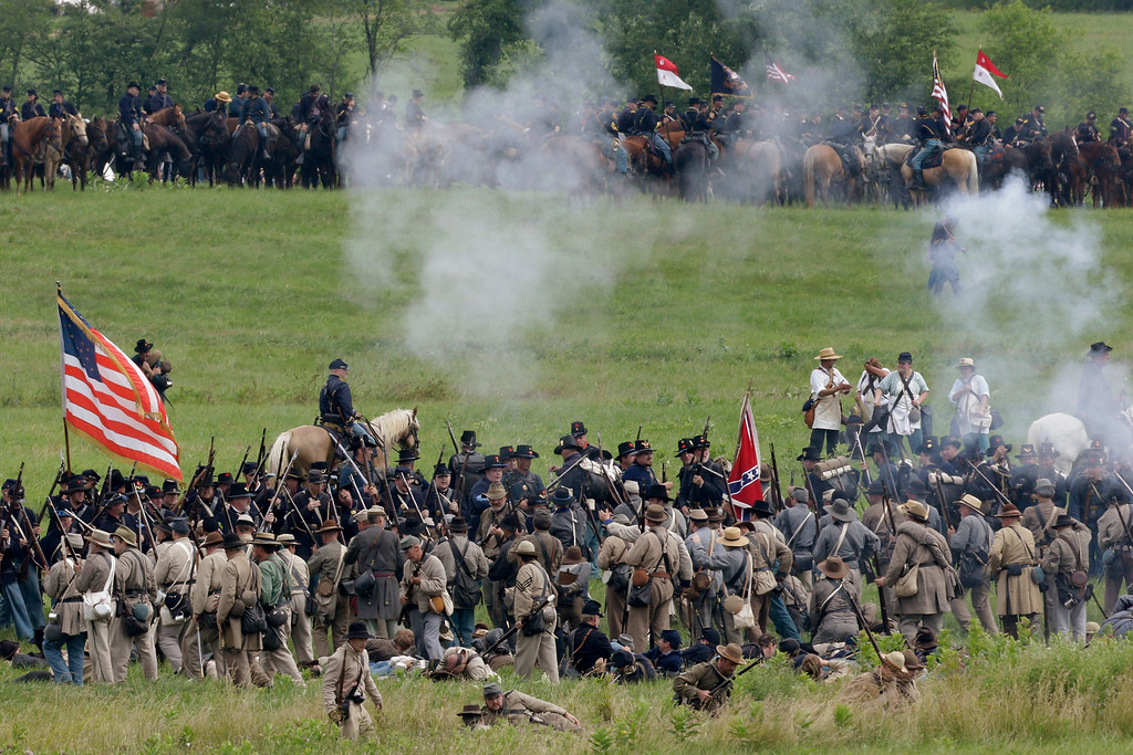 . Reenactors demonstrate a battle during ongoing activities commemorating the 150th anniversary of the Battle of Gettysburg, Friday, June 28, 2013, at  at Bushey Farm in Gettysburg, Pa.  Union forces turned away a Confederate advance in the pivotal battle of the Civil War fought July 1-3, 1863, which was also the warís bloodiest conflict with more than 51,000 casualties. (AP Photo/Matt Rourke)