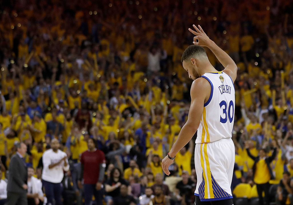 . Golden State Warriors guard Stephen Curry (30) reacts after the Warriors scored against the Cleveland Cavaliers during the first half of Game 1 of basketball\'s NBA Finals in Oakland, Calif., Thursday, June 1, 2017. (AP Photo/Marcio Jose Sanchez)