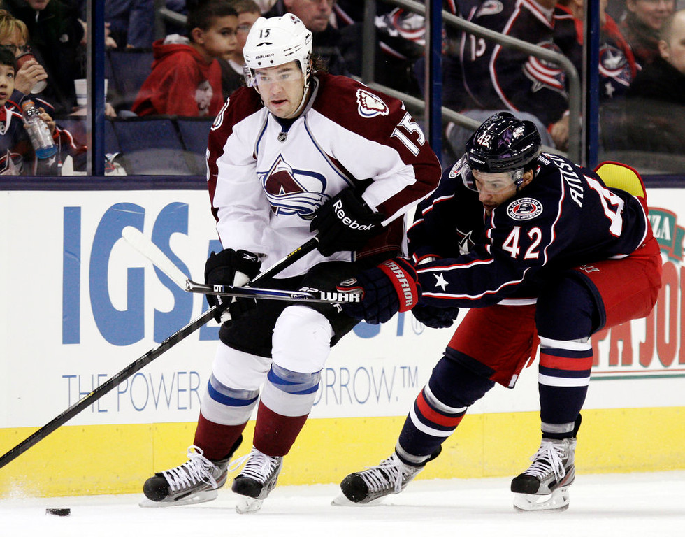 . Colorado Avalanche\'s P.A. Parenteau, left, works for the puck against Columbus Blue Jackets\' Artem Anisimov, of Russia, in the second period of an NHL hockey game in Columbus, Ohio, Sunday, March 3, 2013. (AP Photo/Paul Vernon)
