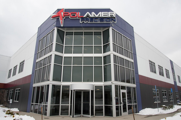 12/04/19 Wesley Bunnell | StaffrrThe front entrance to Polamer Precision on Alton Brooks Drive. Property behind Polamer is being sold by the city for an upcoming expansion by the company.