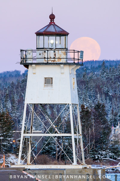 Full Worm Moon Sets Behind the Grand Marais Lighthouse