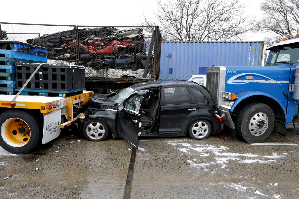 Description of . A section of multi-vehicle accident on Interstate 75 is shown in Detroit, Thursday, Jan. 31, 2013. Snow squalls and slippery roads led to a series of accidents that left at least three people dead and 20 injured on a mile-long stretch of southbound I-75. More than two dozen vehicles, including tractor-trailers, were involved in the pileups. (AP Photo/Paul Sancya)