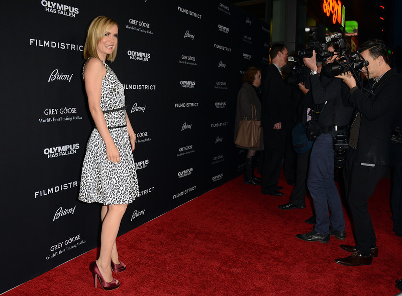 """. Radha Mitchell arrives at the LA premiere of \""""Olympus Has Fallen\"""" at the ArcLight Theatre on Monday, March 18, 2013 in Los Angeles. (Photo by Jordan Strauss/Invision/AP)"""