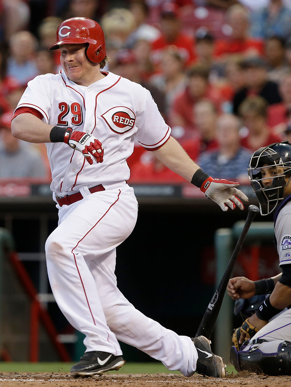 . Cincinnati Reds\' Ryan Hanigan hits a double off Colorado Rockies starting pitcher Juan Nicasio to drive in a run in the fourth inning of a baseball game, Tuesday, June 4, 2013, in Cincinnati. Yorvit Torrealba catches at right. (AP Photo/Al Behrman)