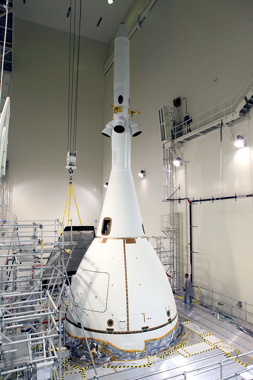. This NASA image released on November 6, 2014 shows Orion as it prepares to move to launch pad. On December 4, 2014 Orion is scheduled to launch atop a United Launch Alliance Delta IV Heavy rocket from Cape Canaveral Air Force Stations Space Launch Complex 37 in Florida. During the test, Orion will travel 3,600 miles in altitude above Earth. 4 1/2 hours later, the spacecraft will reenter the atmosphere at 20,000 mph and splash down in the Pacific Ocean. Orion\'s first flight will verify launch and high-speed reentry systems such as avionics, attitude control, parachutes and the heat shield. Four recently-installed protective panels make up Orion\'s Ogive. The Ogive reduces drag and acoustic load on the crew module, making it a smoother ride for the spacecraft. Pictured here, inside the Launch Abort System Facility at NASAs Kennedy Space Center in Florida, a crane brings the fourth and final Ogive panel closer for installation on Orion\'s Launch Abort System. The Ogive installation was one of the last pieces of the puzzle for Orion prior to its move to the launch pad on November 10, 2014. There, it will be lifted and attached to the rocket for its December launch.  AFP PHOTO HANDOUT-NASA/Getty Images