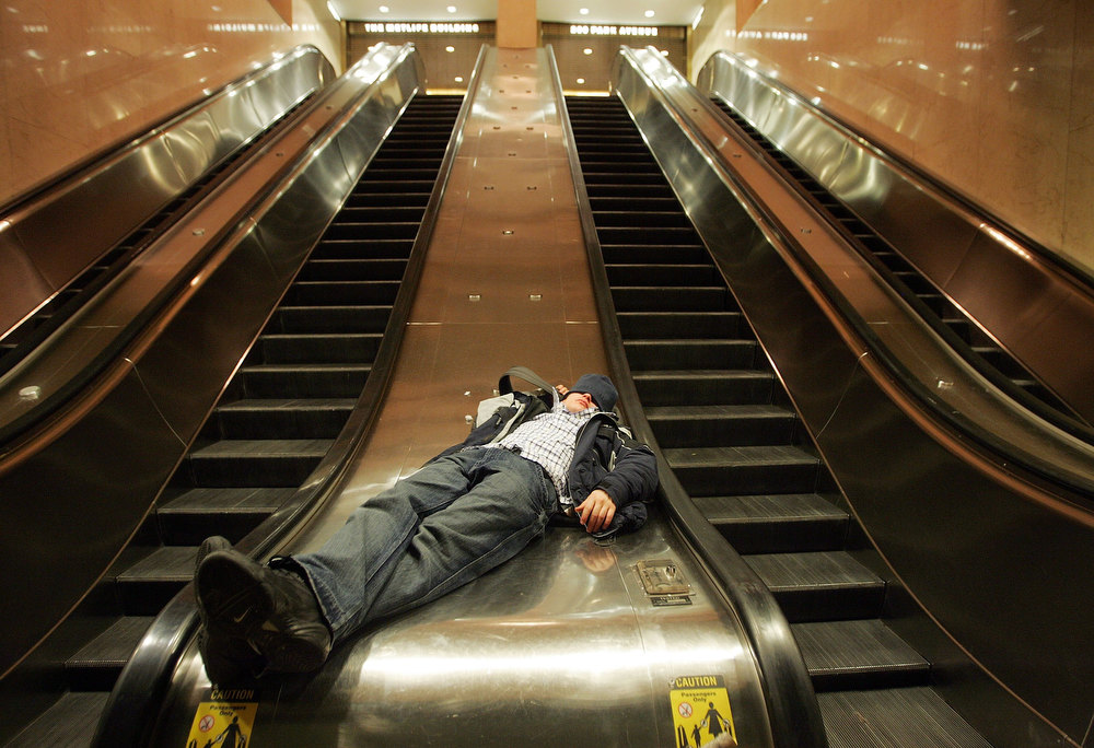 Description of . A reveler sleeps in Grand Central Station while waiting for a train home January 1, 2007 in New York City. Partygoers from around the globe descended on the city to help ring in 2007.  (Photo by Mario Tama/Getty Images)