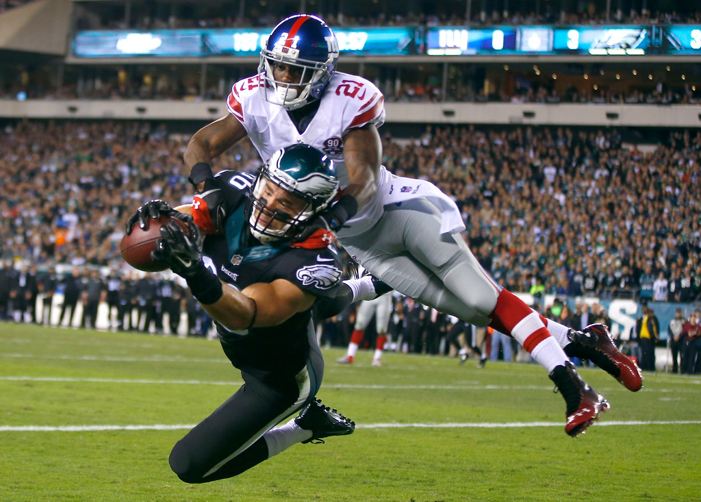 . Philadelphia Eagles tight end Zach Ertz (86) makes a touchdown catch against New York Giants cornerback Dominique Rodgers-Cromartie (21) during the first half of an NFL football game, Sunday, Oct. 12, 2014, in Philadelphia. (AP Photo/Matt Rourke)
