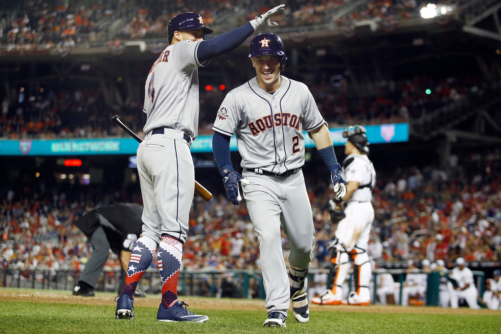 . Houston Astros George Springer (4) congratulates Houston Astros Alex Bregman (2) on Bregman\'s solo home run during the tenth inning at the Major League Baseball All-star Game, Tuesday, July 17, 2018 in Washington. (AP Photo/Patrick Semansky)