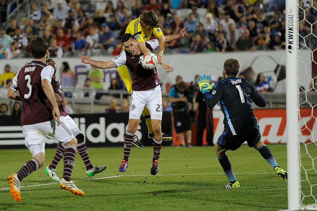 . Shane O\'Neill #27 of the Colorado Rapids tries to stop a ball with goaltender Clint Irwin #1 of the Colorado Rapids during an MLS game against the Columbus Crew at Dick\'s Sporting Goods Park on July 4, 2014, in Commerce City, Colorado. (Photo by Daniel Petty/The Denver Post)
