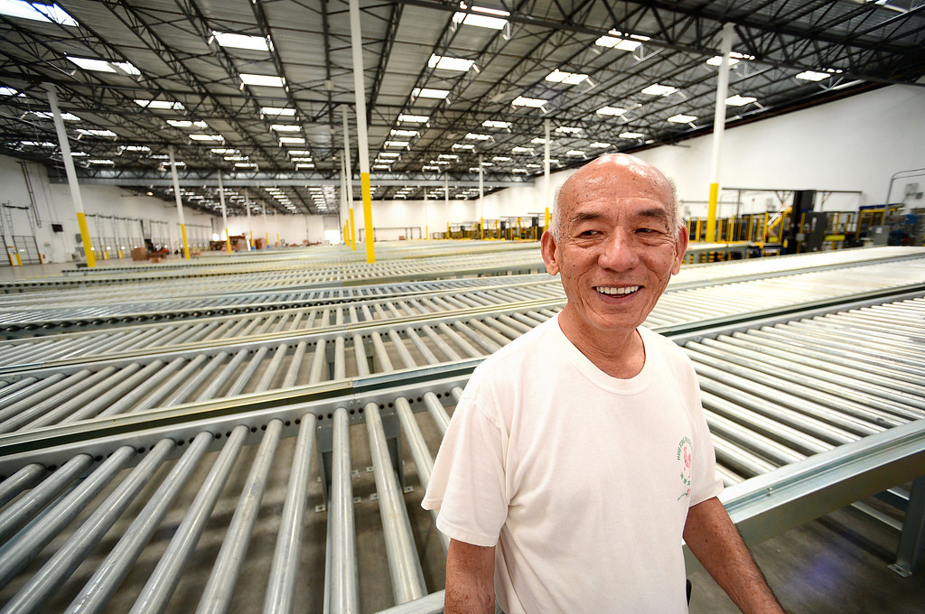. David Tran, owner of Huy Fong Foods, shows his new $50 million  650,000 square foot factory in Irwindale where he plans to move his company, the maker of the famous Sriracha chili sauce. Tran says he expects the company to outgrow the new facility by 2017. (SGVN/Staff Photo by Sarah Reingewirtz)
