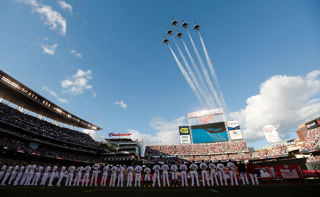 . American League players stand on the field before the MLB All-Star baseball game, Tuesday, July 15, 2014, in Minneapolis. (AP Photo/Jeff Roberson)