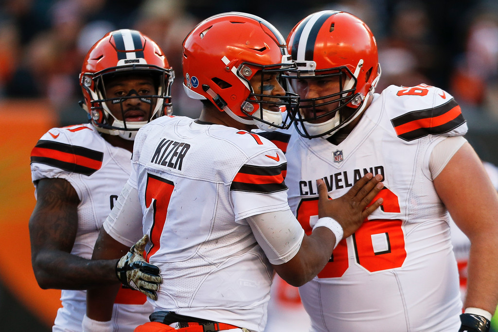 . Cleveland Browns quarterback DeShone Kizer (7) celebrates with offensive tackle Spencer Drango (66) after scoring a touchdown in the second half of an NFL football game, Sunday, Nov. 26, 2017, in Cincinnati. (AP Photo/Gary Landers)