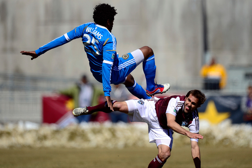 . COMMERCE CITY, CO - MARCH 10: Brian Mullan (11) of the Colorado Rapids and Sheanon Williams (25) of the Philadelphia Union collide during the first half of action. The Colorado Rapids play the Philadelphia Union at Dick\'s Sporting Goods Park. (Photo By AAron Ontiveroz/The Denver Post)
