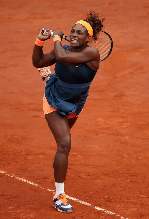 . Serena Williams of United States of America plays a backhand in her Women\'s Singles Final match against Maria Sharapova of Russia  during day fourteen of French Open at Roland Garros on June 8, 2013 in Paris, France.  (Photo by Clive Brunskill/Getty Images)