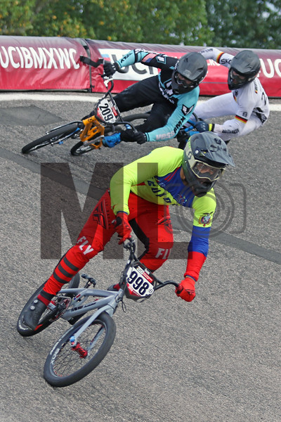 Wilson Goyes Larrea (998) of Ecuador, Cameron Moore (209) of the United States and Axel Webster (250) of Germany race at the UCI BMX Supercross World Cup Round 8 at Rock Hill, S.C., on Saturday, Sept. 14, 2019.