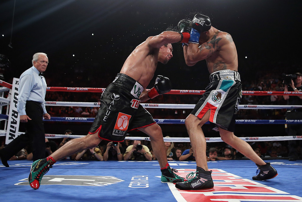 . INGLEWOOD, CA - MAY 17:  Juan Manuel Marquez (L) lands a right hand to the head of Mike Alvarado at The Forum on May 17, 2014 in Inglewood, California.  (Photo by Jeff Gross/Getty Images)