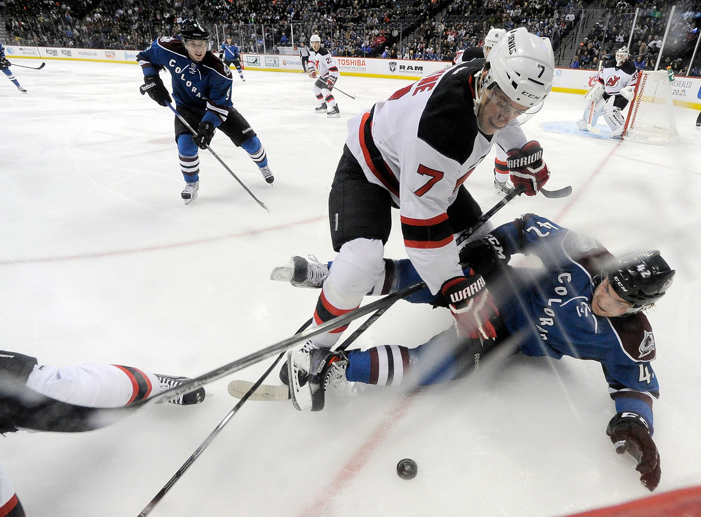 . Colorado Avalanche center Brad Malone (42) hits the ice as New Jersey Devils defenseman Mark Fayne (7) comes in for the puck during the first period January 16, 2014 at Pepsi Center. (Photo by John Leyba/The Denver Post)