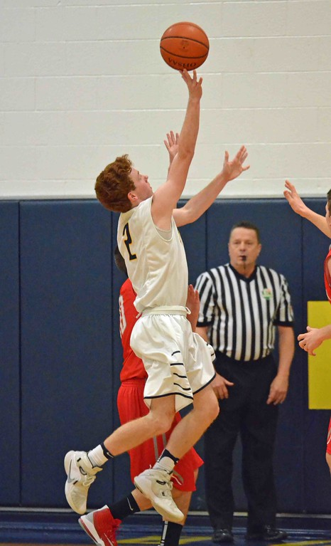 . Paul DiCicco - The News-Herald Kirtland�s Palemr Capretta shoots a running one hander against a tough Hawken defense.