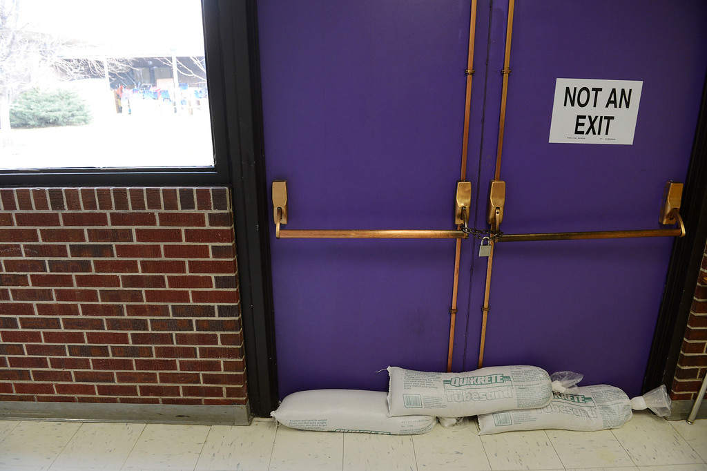 . COMMERCE CITY, CO - NOVEMBER 08:  Sandbags at the bottom of a doorway leading out to a courtyard at Adams 14 Kearney Middle School Friday morning, November 08, 2013. The courtyard has a drain that does not work properly which led to flooding  problems in September. The building is in dire need of repairs, but voters voted against a tax measure that would have replaced the school. (Photo By Andy Cross/The Denver Post)