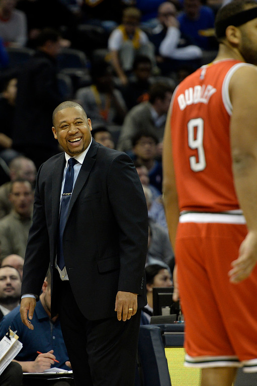 . DENVER, CO - MARCH 03: Melvin Hunt of the Denver Nuggets jokes with players on the court during the second quarter of action against the Milwaukee Bucks. The Denver Nuggets hosted the Milwaukee Bucks at the Pepsi Center on Tuesday, March 3, 2015. (Photo by AAron Ontiveroz/The Denver Post)