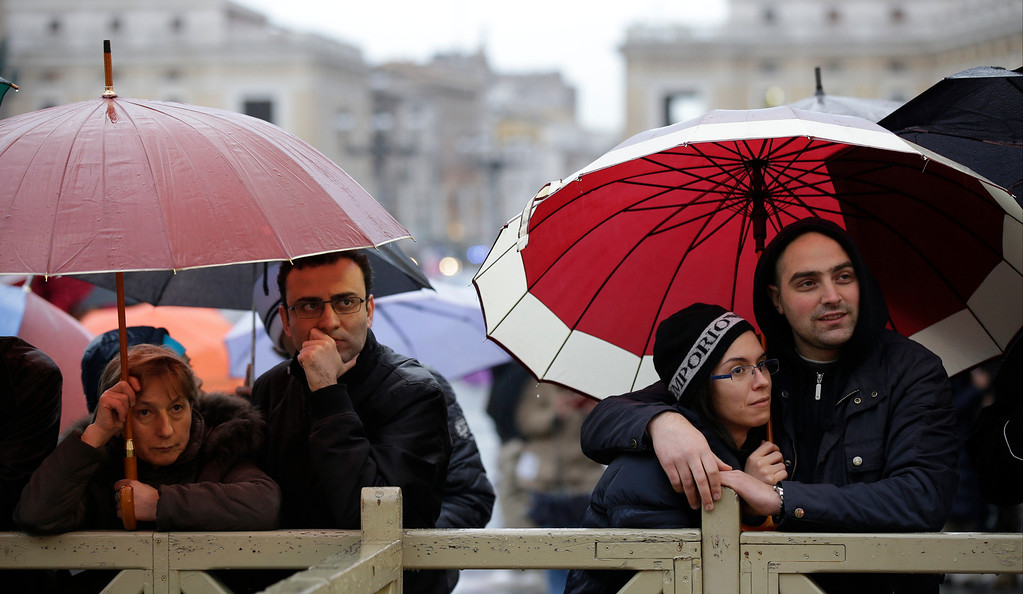 . People stand in St. Peter\'s Square at the Vatican, Tuesday, March 12, 2013.  (AP Photo/Gregorio Borgia)
