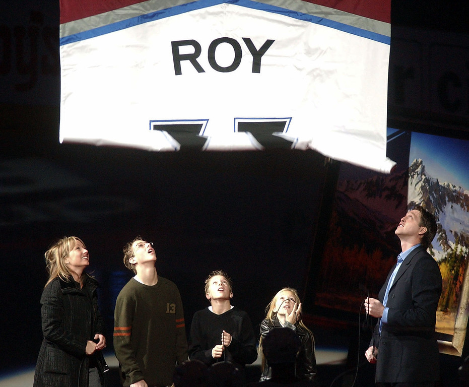 . Former Denver Avalanche goalie Patrick Roy watches as his jersey is unfurled during pre-game ceremonies at the Pepsi Center on Tuesday night Oct. 28th, 2003. From left are his wife, Michele, sosn Jonathan (14) , Frederick (12) and daughter Jana (10). (Steve Dykes/The Denver Post