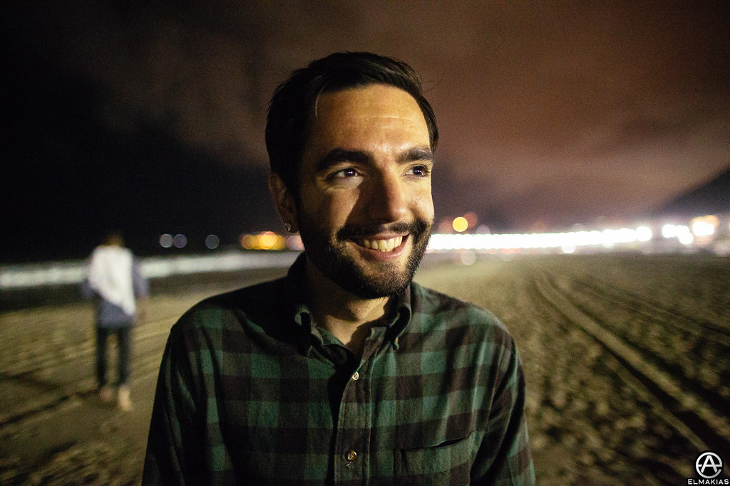 Jeremy McKinnon of A Day to Remember on Copacabana beach at night in Rio