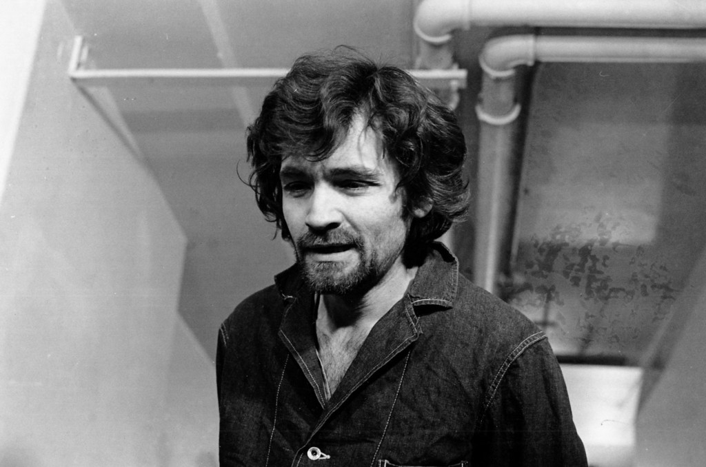 """. Charles Manson is pictured en route to a Los Angeles courtroom on Dec. 17, 1970.  He is being arraigned on charges of murder in the disappearance of Donald J. \""""Shorty\"""" Shea, who vanished about the time of the Sharon Tate murders, for which Manson is on trial.  (AP Photo)"""