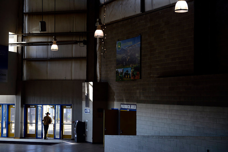 . Chris Whitney walks out of the Events Center as vendors and volunteers work in preparation for the National Western Stock Show at the complex on Wednesday, January 9, 2012.