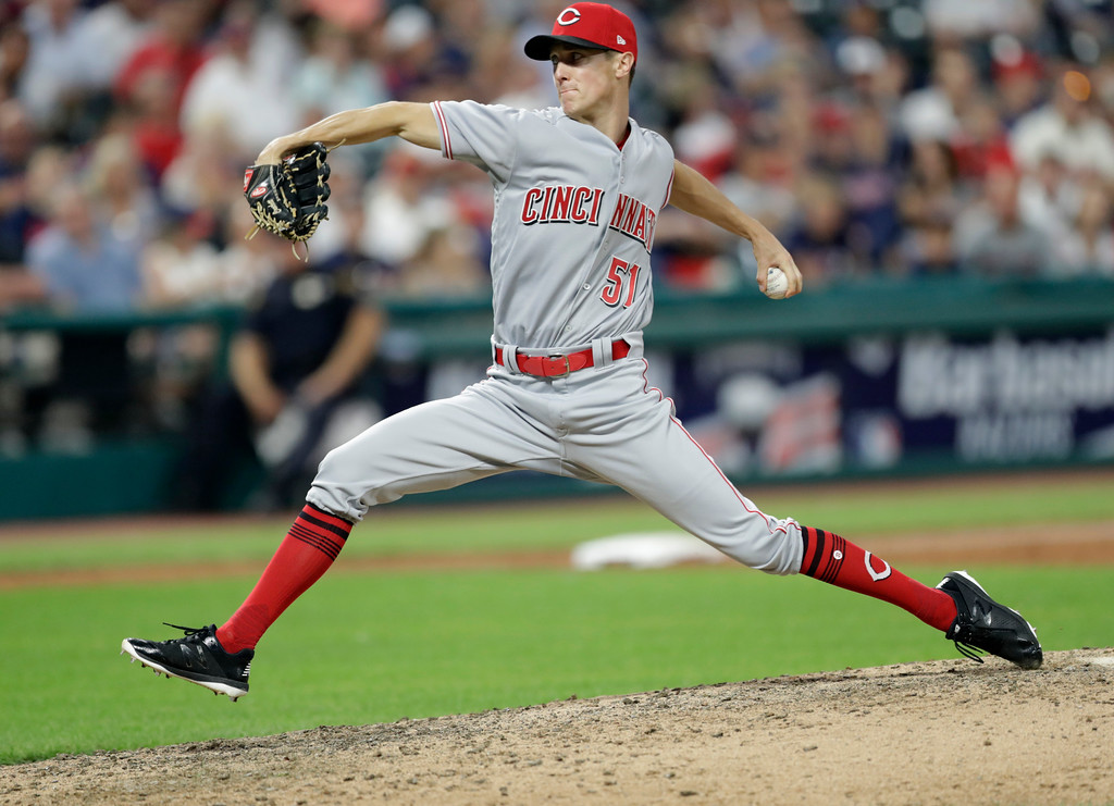 . Cincinnati Reds relief pitcher Kyle Crockett delivers in the eighth inning of a baseball game against the Cleveland Indians, Tuesday, July 10, 2018, in Cleveland. (AP Photo/Tony Dejak)