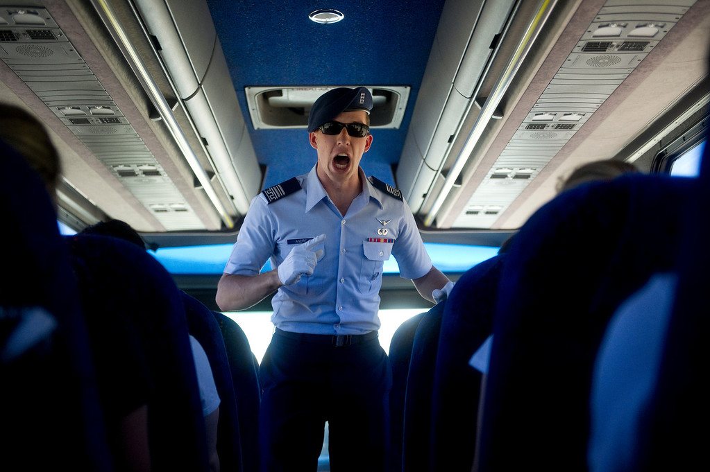 . COLORADO SPRINGS, CO. - JUNE 27: Air Force Cadre Andre, class of 2015, yells at a bus of Basic Cadet Trainees on their way to the central campus of the Air Force Academy for inprocessing on June 27, 2013. (Photo By Grant Hindsley/The Denver Post)