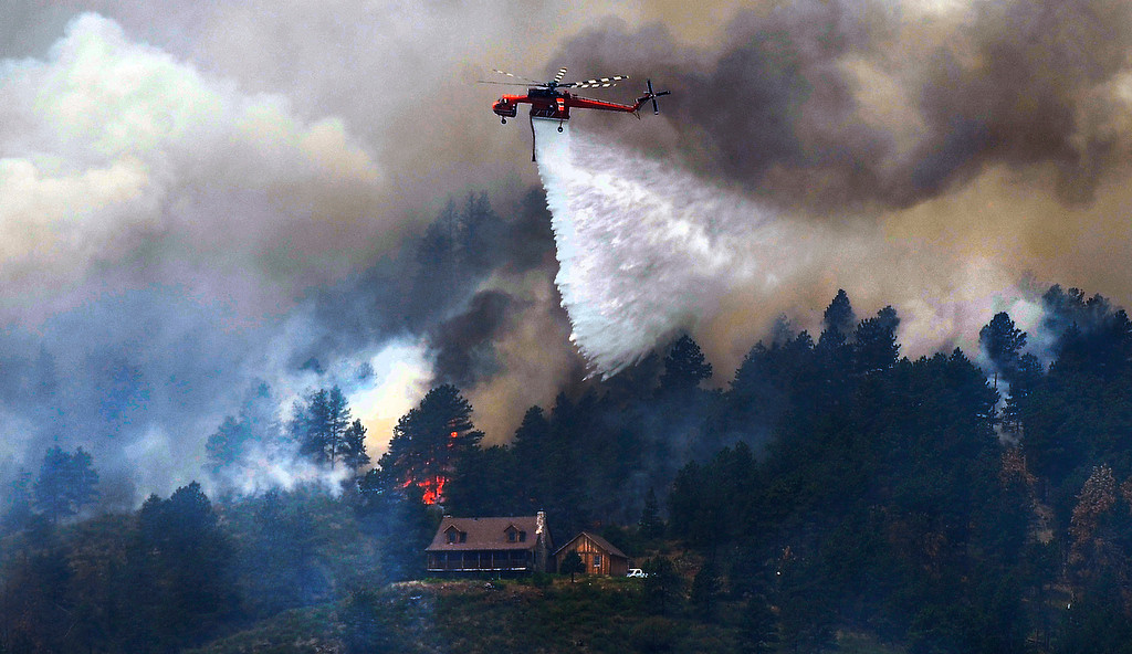 . Crews fight the High Park fire from the air as it continues to grow near homes in an evacuation area just northwest of Horsetooth Reservoir, Monday, June 11, 2012, near Fort Collins. RJ Sangosti, The Denver Post