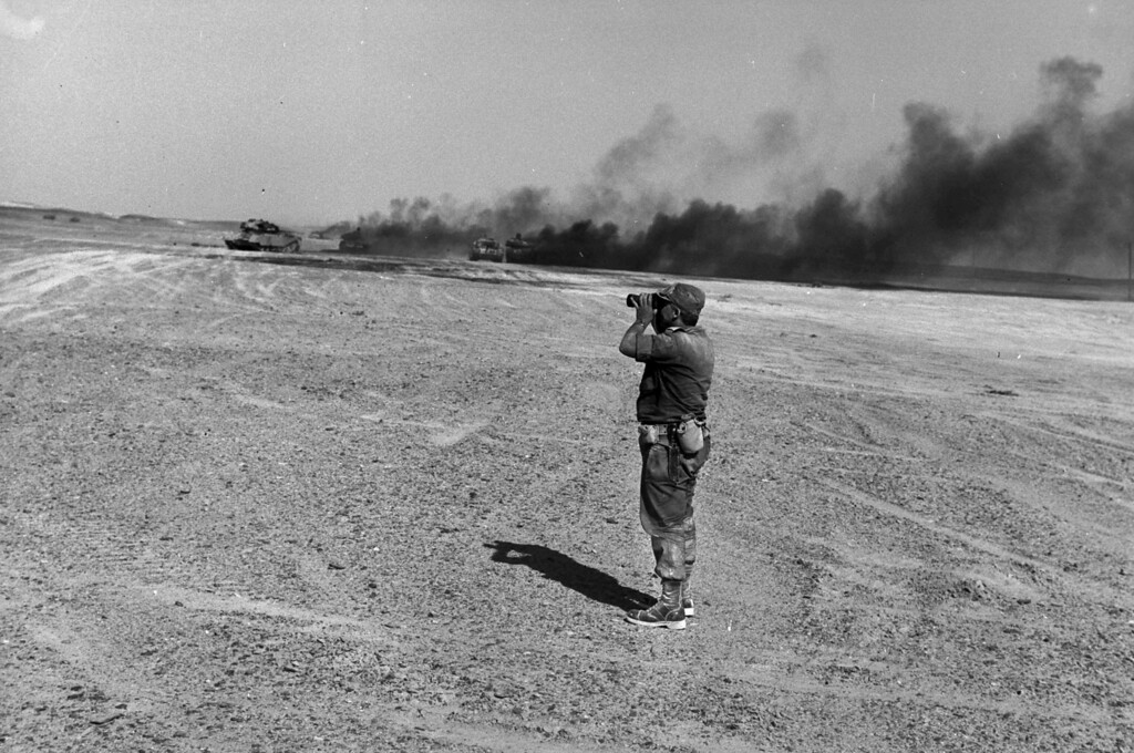 . In this handout from the Israeli Governmental Press Office, Brigadier General Ariel Sharon watching an aerial drop in the Sinai Desert during the Six Day War June 8, 1967 in the Sinai Desert, Egypt. (Photo by Yossi Greenberg/GPO via Getty Images)