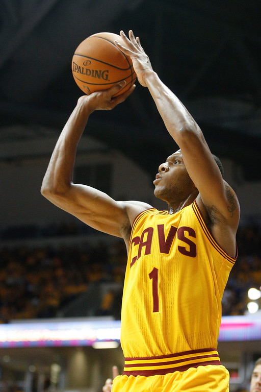 . Cleveland Cavaliers guard James Jones (1) takes a three-point shot in the first half of an NBA preseason basketball game against the Atlanta Hawks, Wednesday, Oct. 7, 2015, in Cincinnati. The Hawks won 98-96. (AP Photo/John Minchillo)