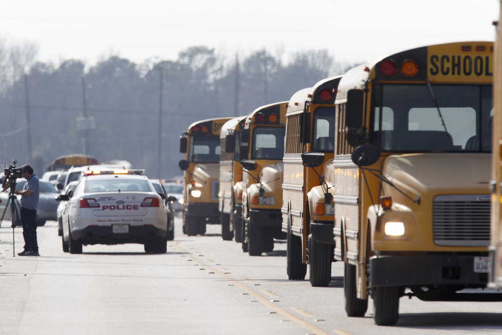 . Buses wait to pick up children from area elementary schools after a shooting occurred at Lone Star College Campus on January 22, 2013 in The Woodlands, Texas. According to reports, three people were injured during a shooting on the courtyard between the Library and cafeteria.  (Photo by Thomas B. Shea/Getty Images)