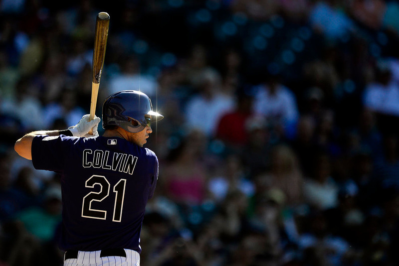 . DENVER, CO - JUNE 9: Colorado Rockies right fielder Tyler Colvin (21) bats against the San Diego Padres in the 10th inning during the Rockies\' 8-7 10-inning win in Denver. The Colorado Rockies hosted the San Diego Padres. (Photo by AAron Ontiveroz/The Denver Post)